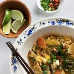 Thai Red Curry with limes, green onions, and chilis