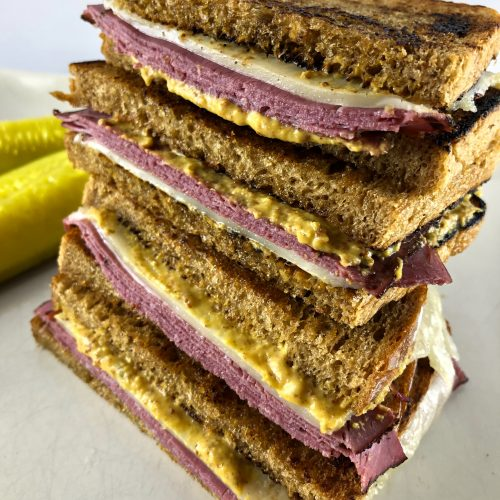 Pastrami and Swiss on Rye With Pickles