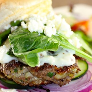 Greek lamb burger with onion cucumber spinach and feta