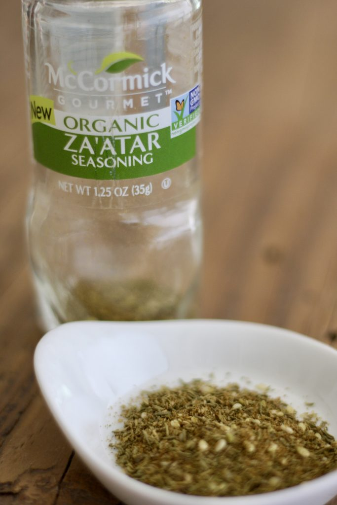 Bottle of McCormick Za'atar and some za'atar in a white dish