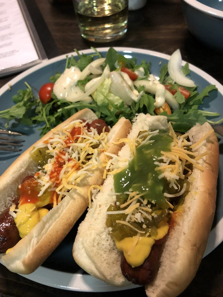 Hot dogs and salad on a plate