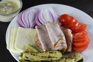Turkey, red onion, tomatoes, havarti cheese, grilled zucchini, and mustard and mayo dressing