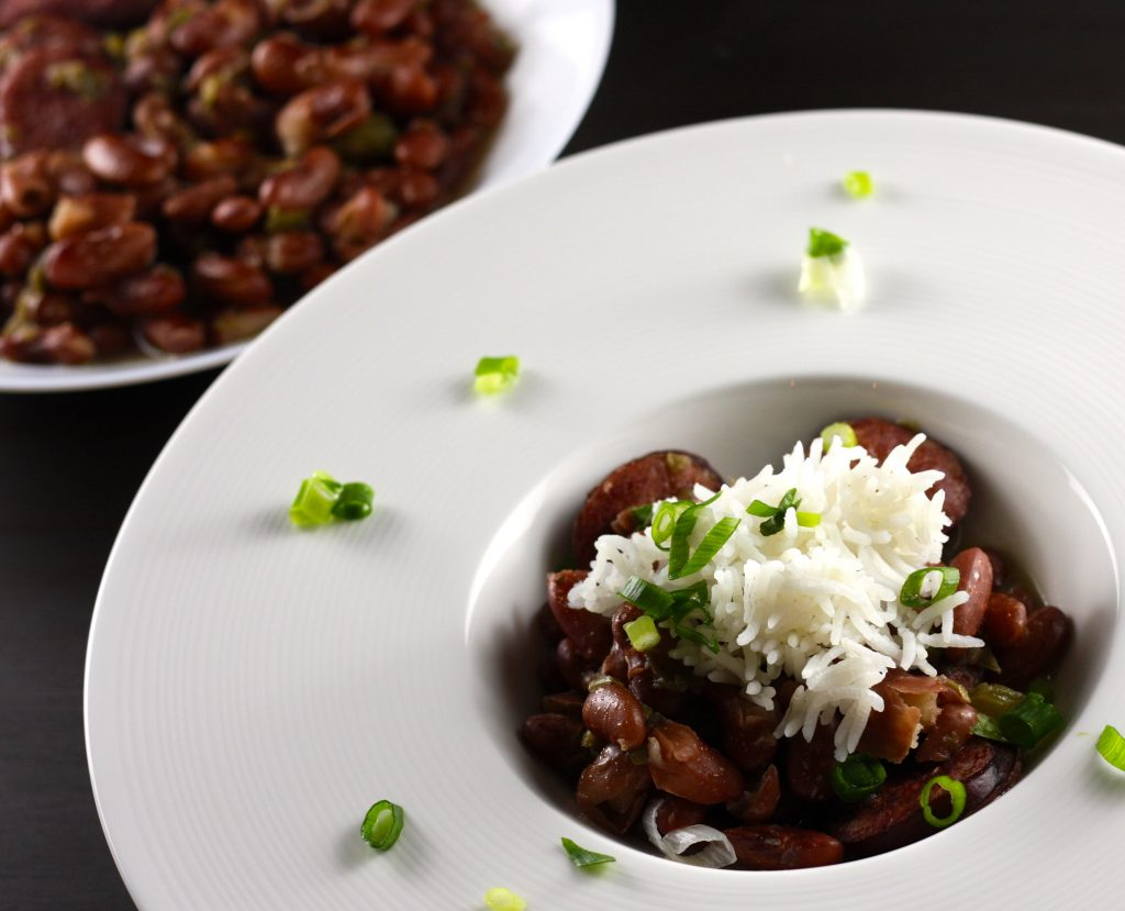 New Orleans Style Red Beans and Rice in a bowl with green onions scattered