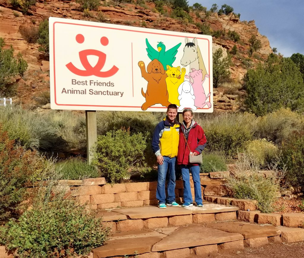 Best Friends Animal Sanctuary Sign With People and Cliffs