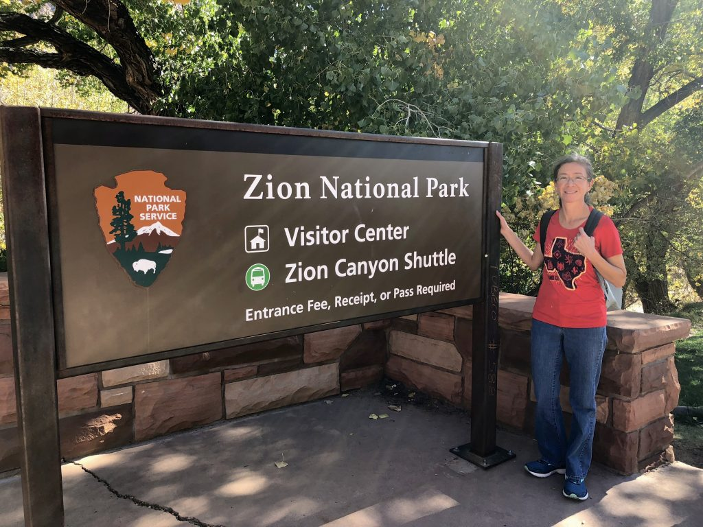 Female with Zion National Park Sign