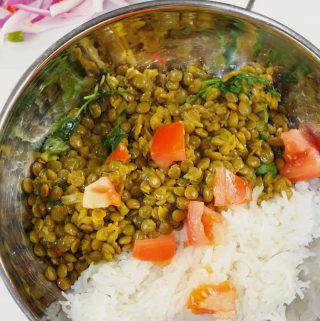 Indian Spiced Lentils With Onion Salad and rice in a bowl