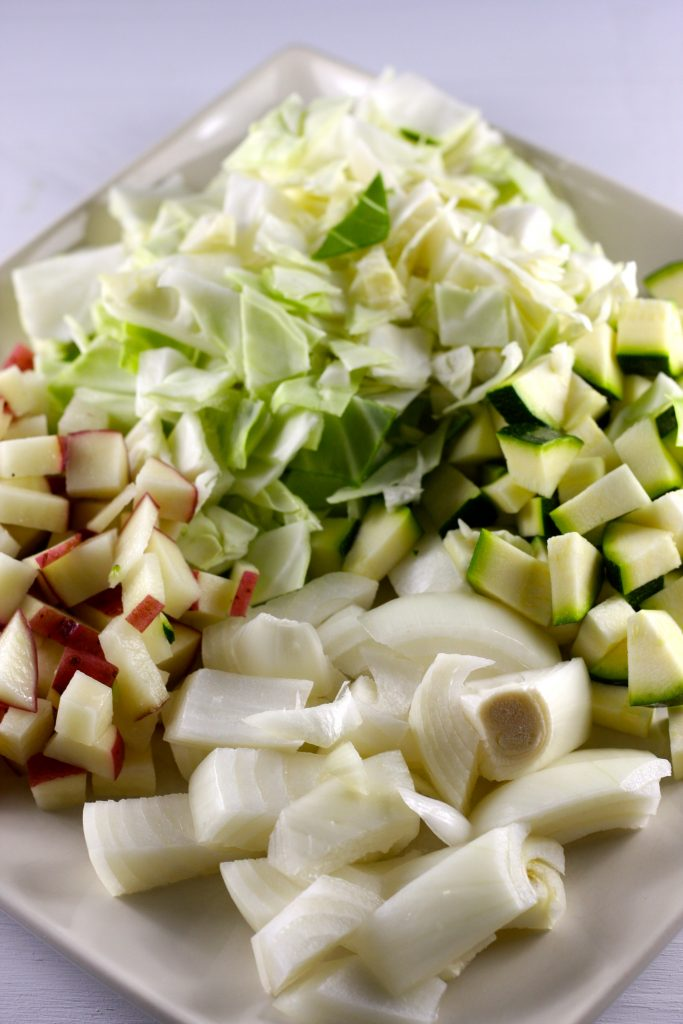 Diced cabbage, onion, zucchini, and potato