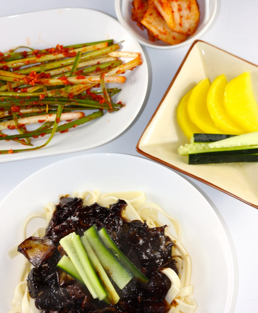 Jajangmyeon and Banchan including pickled radish and pa kimchi