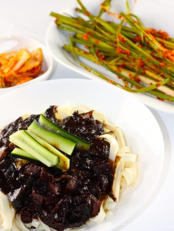 Jajangmyeon with cucumber matchisticks and kimchi