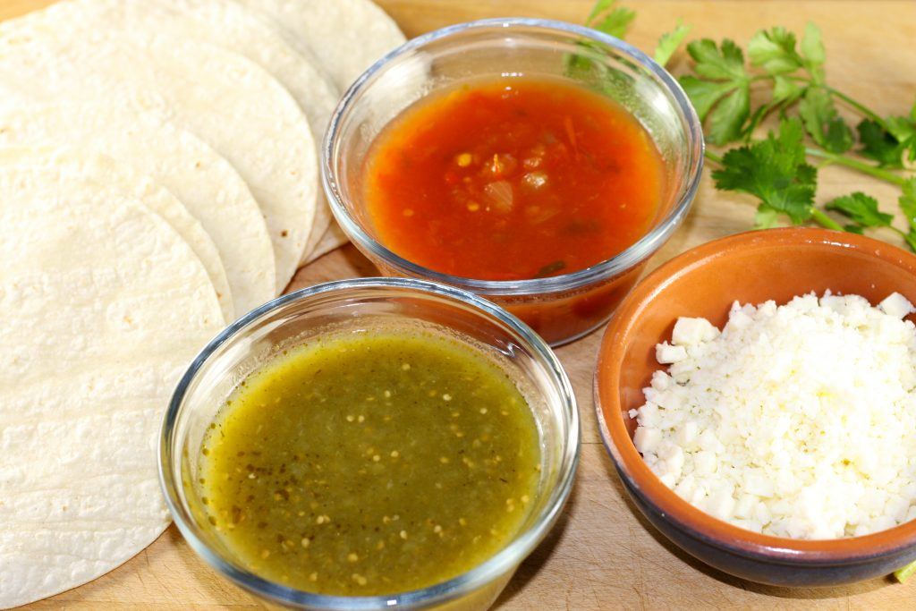 Tortillas, red and green salsas, cilantro and queso fresco
