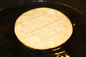 Frying corn tortilla