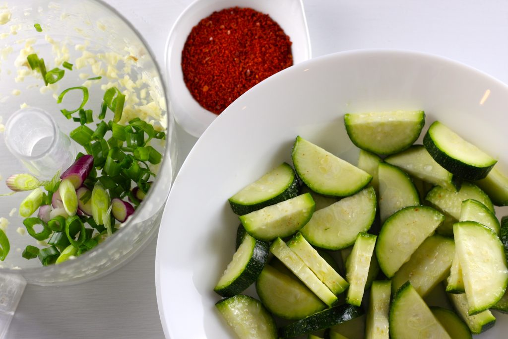 cut zucchini, korean red pepper flakes, garlic and green onion in a food processor