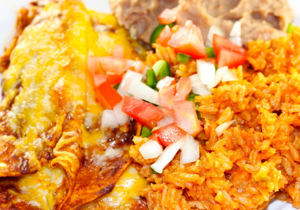 Red Cheese Enchiladas, refried beans and spicy mexican rice