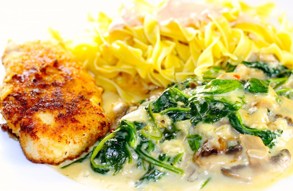 Russian ground beef cutlets with creamed spinach and mushrooms and egg noodles