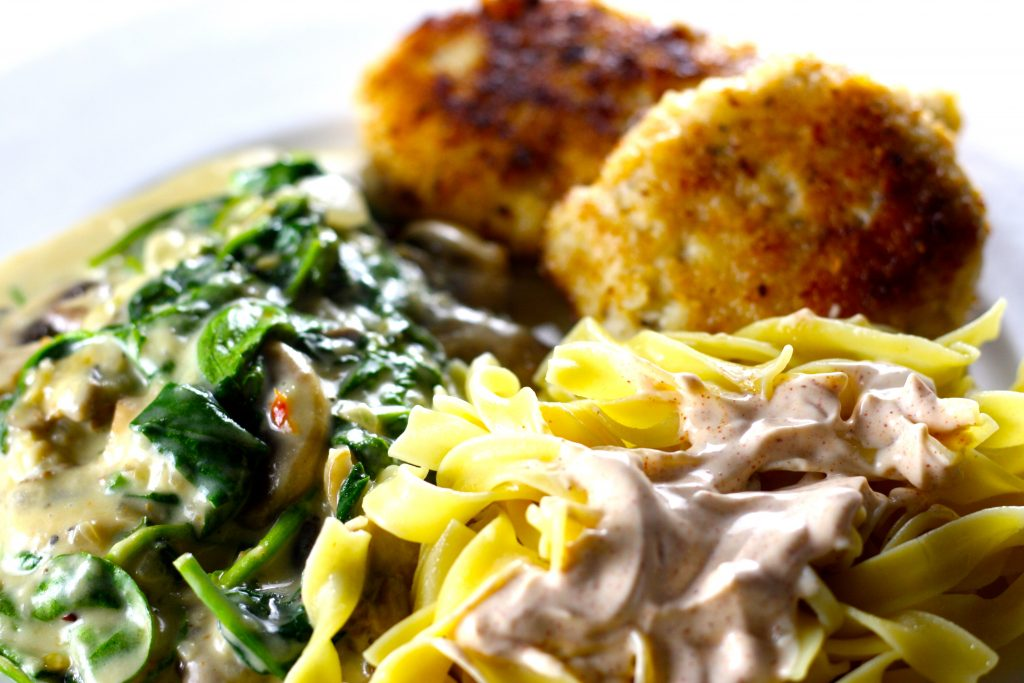 Russian Ground chicken Cutlets creamed mushroom and spinach and egg noodles with paprika sour cream