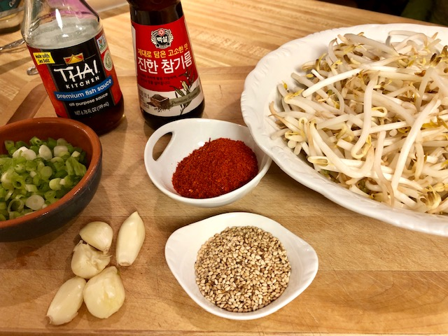 Korean Spicy Bean Sprouts, fish sauce, sesame oil, garlic, sesame seeds, green onions, and korean red pepper