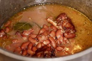 Beans ham hock and bay leaf in a pot