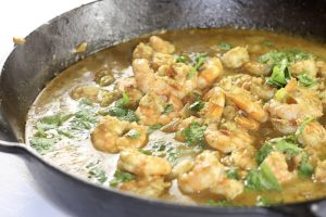 coconut curry shrimp in a cast iron pan