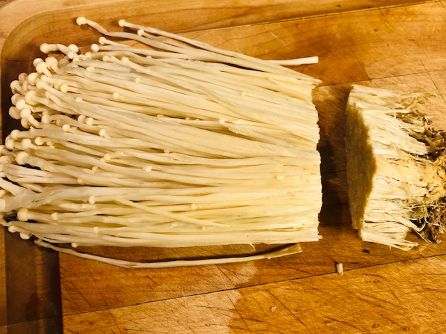enoki mushrooms cut inch from the bottom