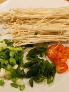 enoki mushroom, green onion, green pepper, and red pepper