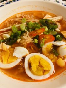 Korean Soft Tofu Broth With Shrimp, egg, enoki mushrooms, green onion, green pepper and red pepper