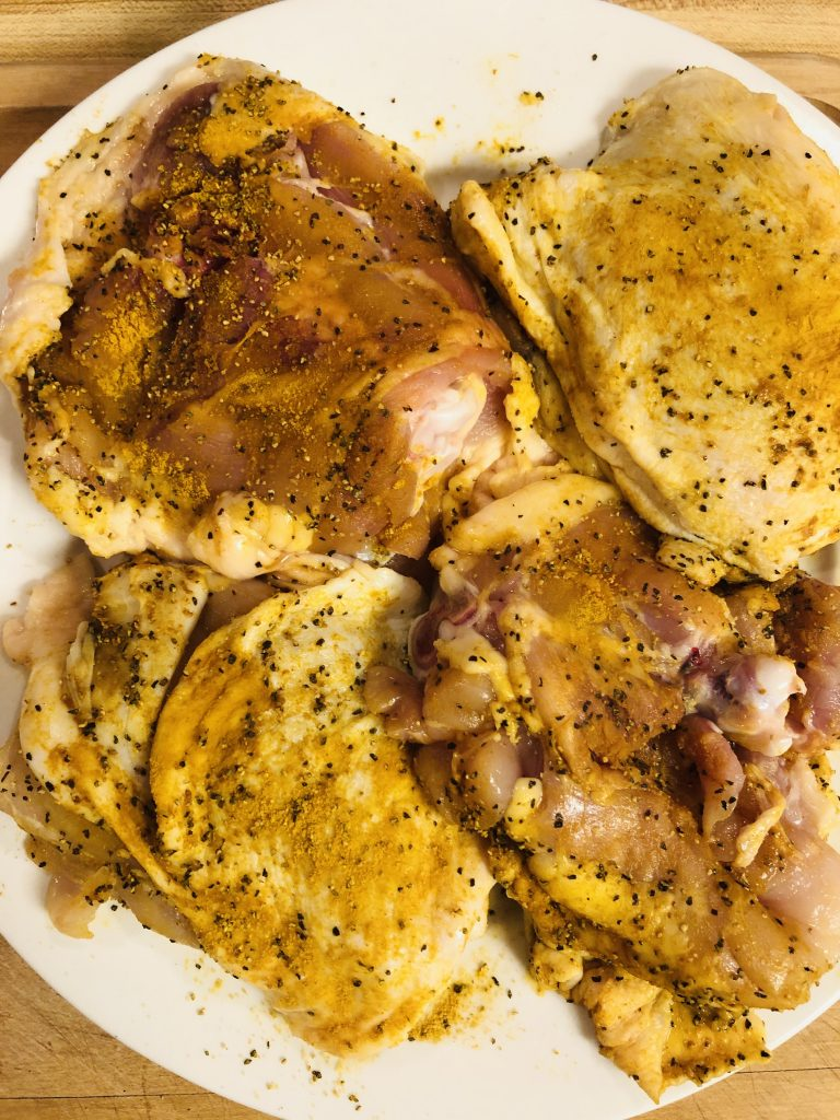 chicken seasoned with turmeric, salt, and pepper