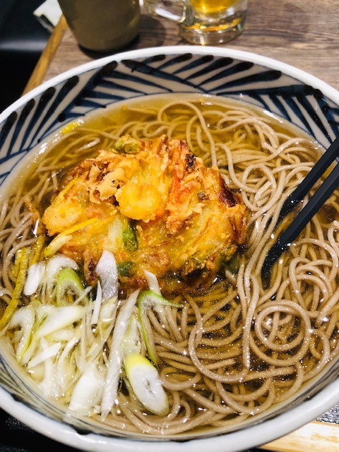 hot soba noodles with tempura in a bowl with chopsticks