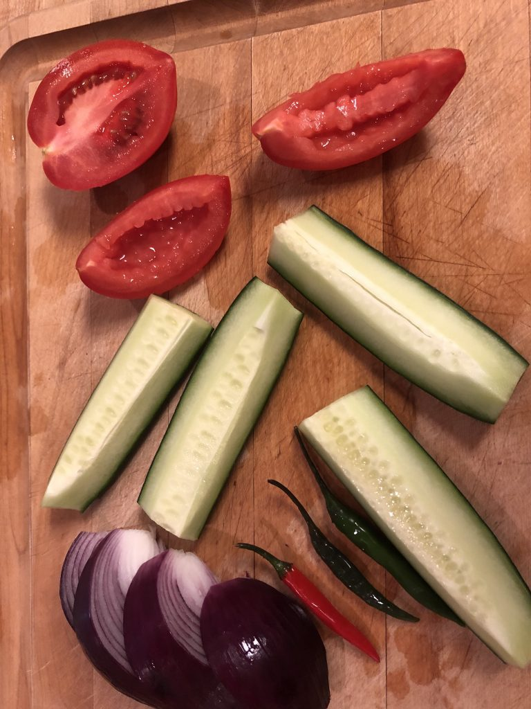 tomato, cucumber, chilis, and red onion