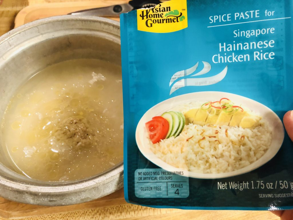 Hainanese Chicken Rice Packet and rice and spice pasted in a rice cooker