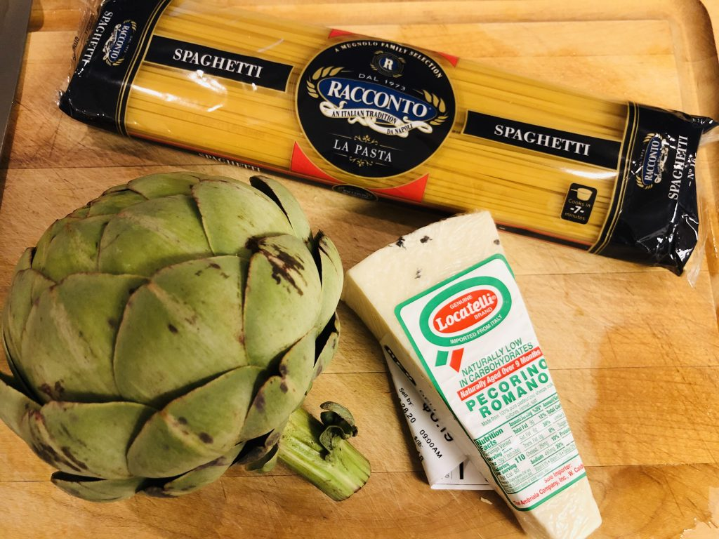 Pecorino cheese, spaghetti, and an artichoke