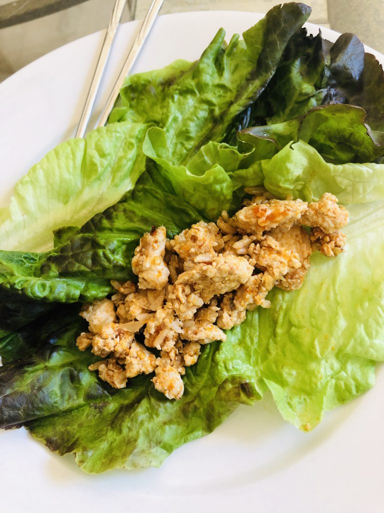 Asian Chicken Lettuce Wraps on a plate with chopsticks