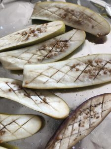 Japanese eggplant cut in half and scored