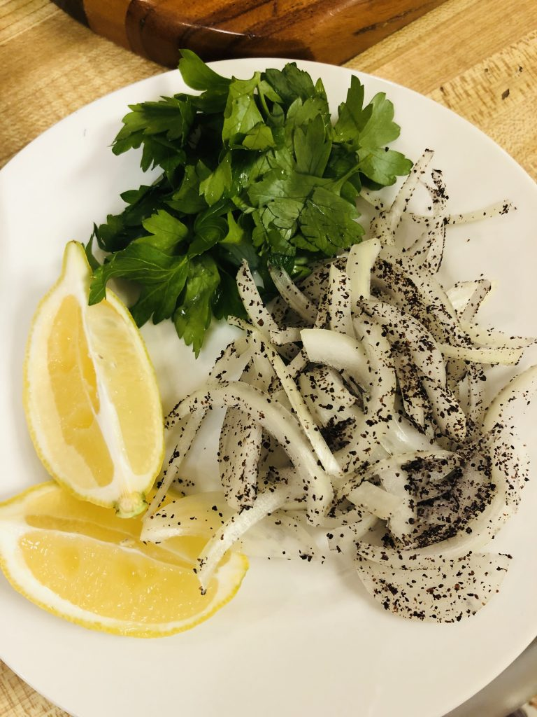 Lemon wedges, parsley, and onion and sumac
