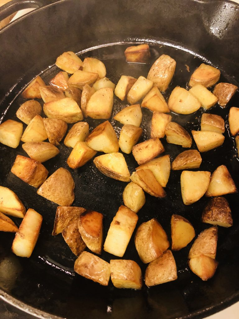 bite sized potatoes frying in a pan