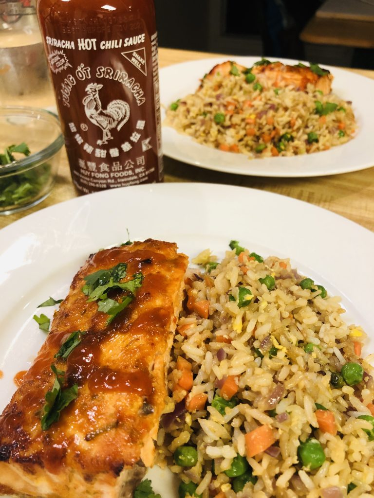 Salmon with Sriracha Sauce, fried rice, and Huy Fong Sriracha Sauce