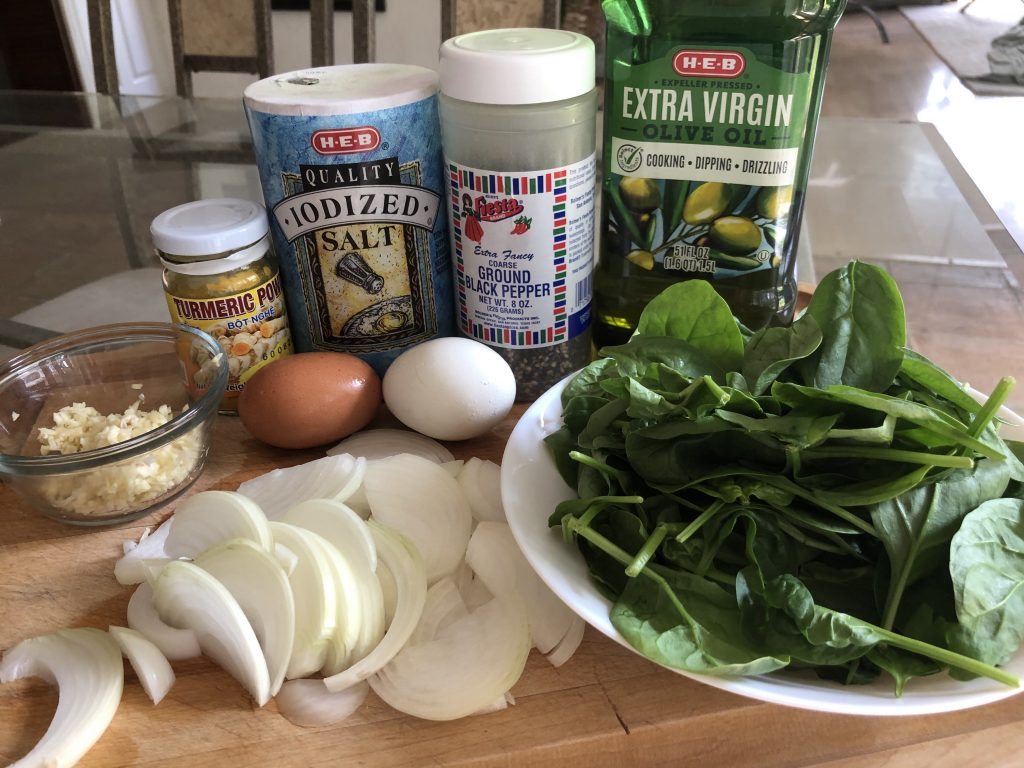 Salt, pepper, turmeric, garlic, onion, spinach, eggs, olive oil
