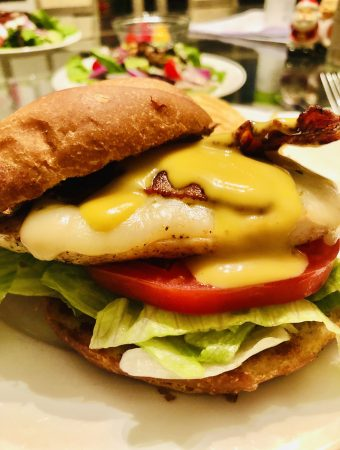 Grilled Chicken Sandwich with bacon, pepper jack cheese, tomato, lettuce, honey mustard dressing in a kaiser roll