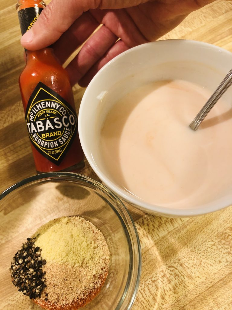 Buttermilk, spices, and Tabasco Scorpion sauce