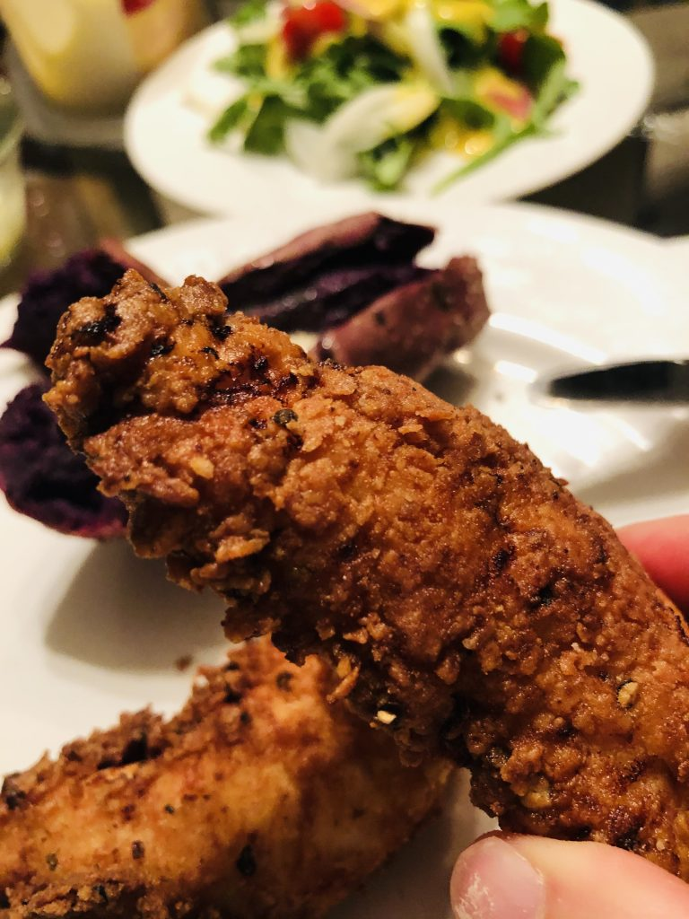 Spicy Chicken Tenders with purple potato in the background
