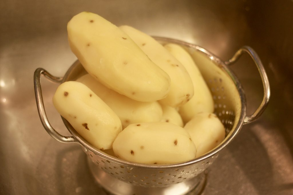 Peeled Potatoes in a colander