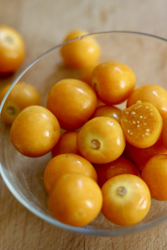 Cape Gooseberry in a glass bowl with a few scattered around