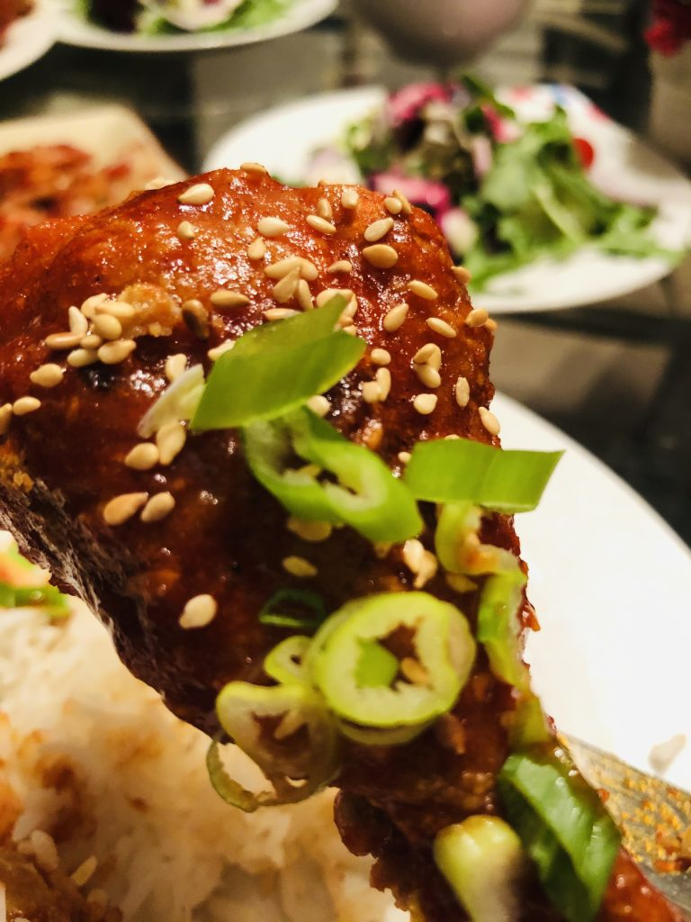 Korean Baked chicken with green onions and sesame seeds