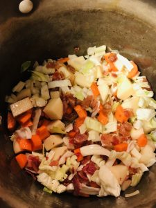 Bacon, potato, carrot, and cabbage in a large stock pot