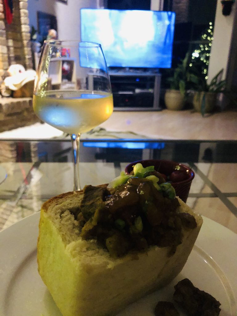 Bunny Chow and a glass of white wine