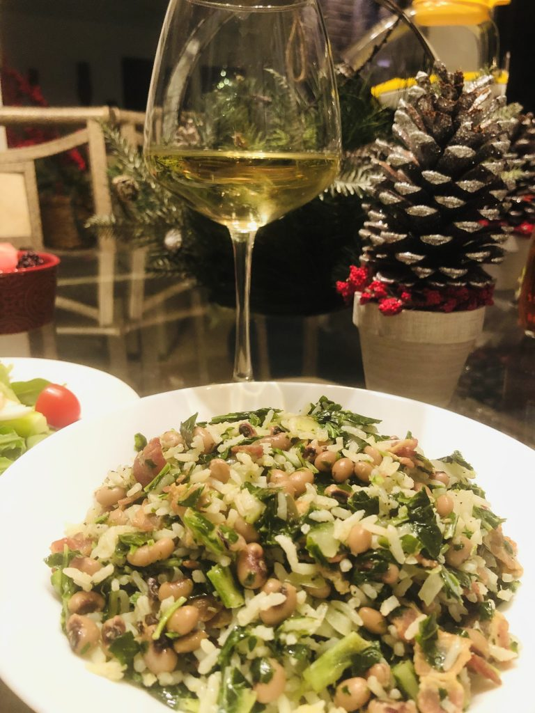 Hoppin' John with greenery and a glass of wine in the background