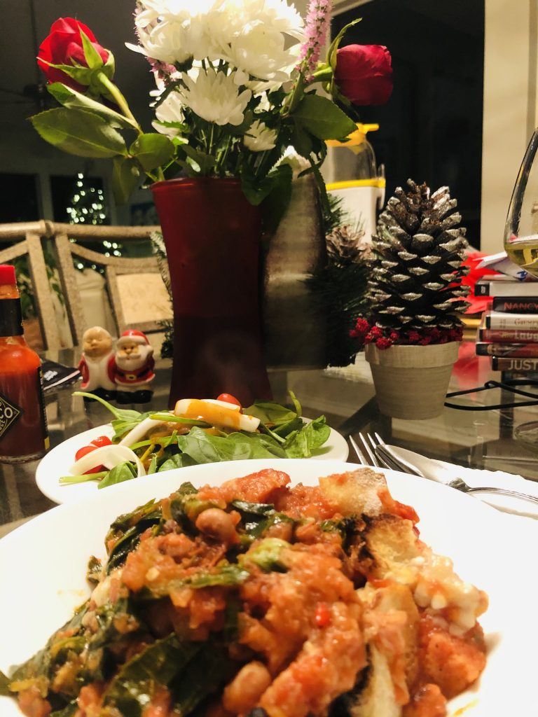 Black-Eyed Pea Ribollita with salad and floral items in the background
