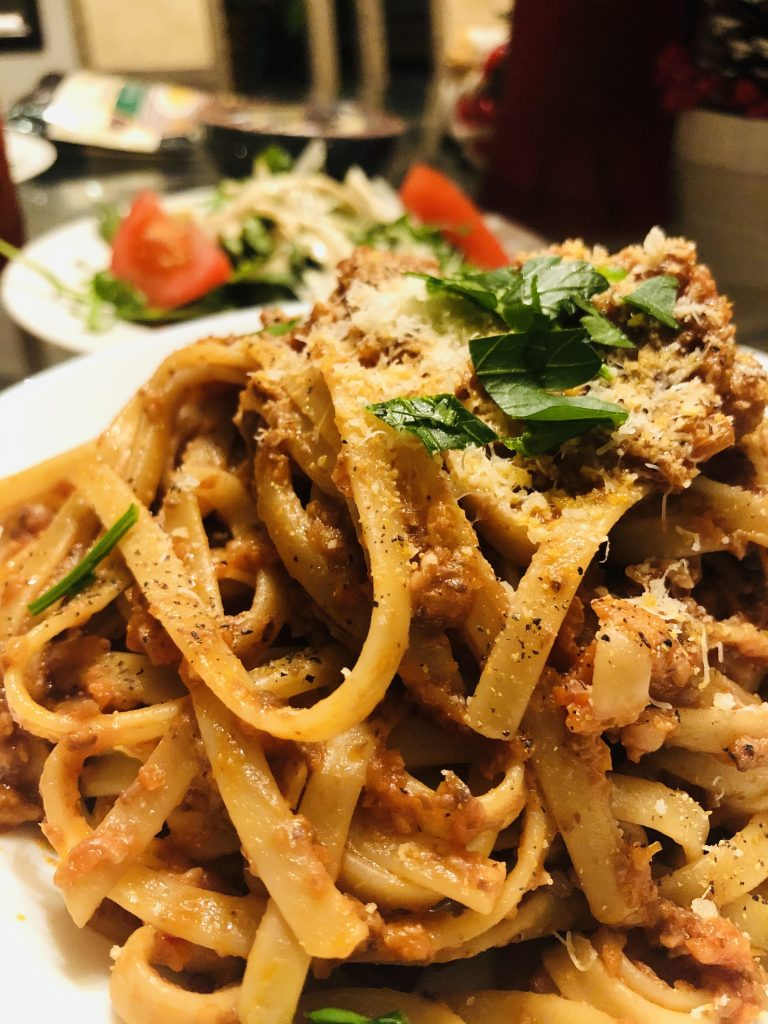 Mushroom-Walnut Bolognese with salad in the background