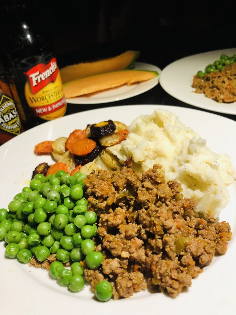 MInce and Tatties with peas, carrots, cantaloupe, and Worcestershire sauce