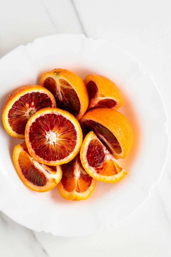 Blood oranges on a white plate
