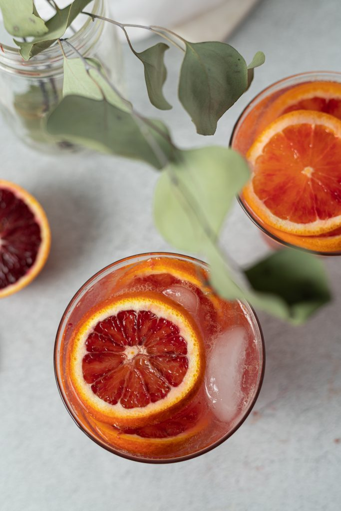 Blood orange cocktail drink and plant